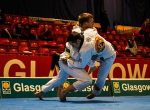 Photo of two men grappling at a Brazillian Jiu Jitsu competition in Glasgow